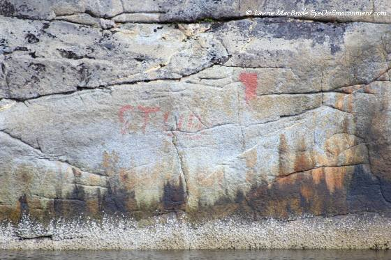 Faded pictograph and natural colours of the rock