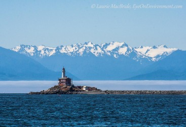 Fisgard Lighthouse with fogbank and the Olympic Mountains behind