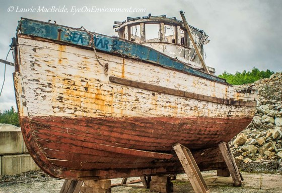 Old wooden fishboat on dry land
