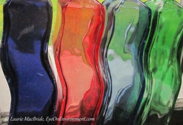 Curving, colourful glass bottles