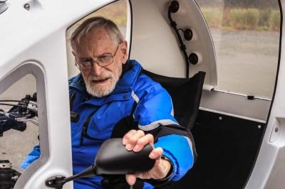 Man adjusting side mirror