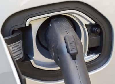 Closeup of electric vehicle plug-in