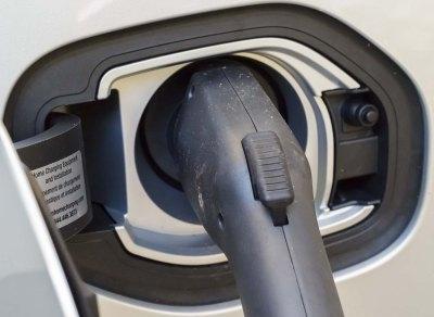 Closeup of electric vehicle plug-in