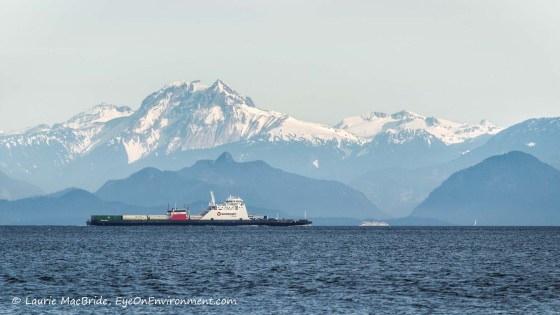 Scenic view of snowy mountains, islands and ferries
