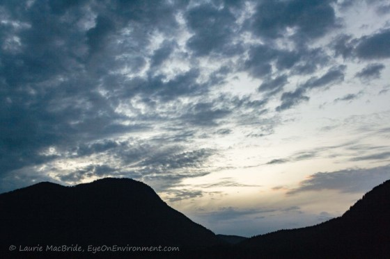 Clouds over mountain in evening sky